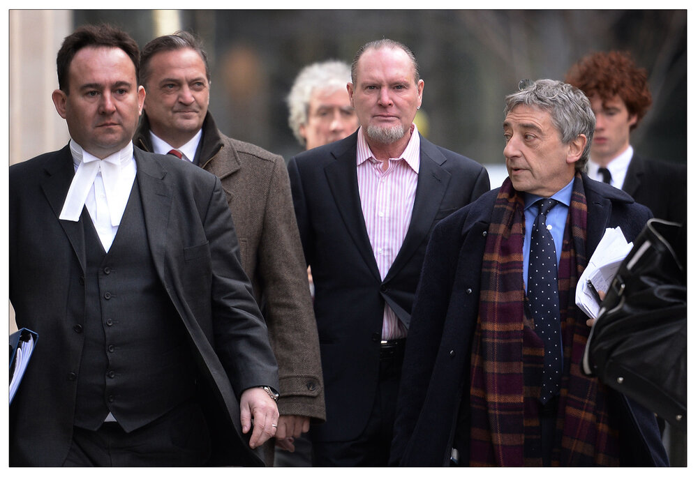 Action:  Paul Gascoigne (middle) arriving at the High Court in London in March 2015 where he gave evidence  en route  to victory in his phone hacking case again Mirror Group Newspapers. (c) Stefan Rousseau/PA Archive/PA Images