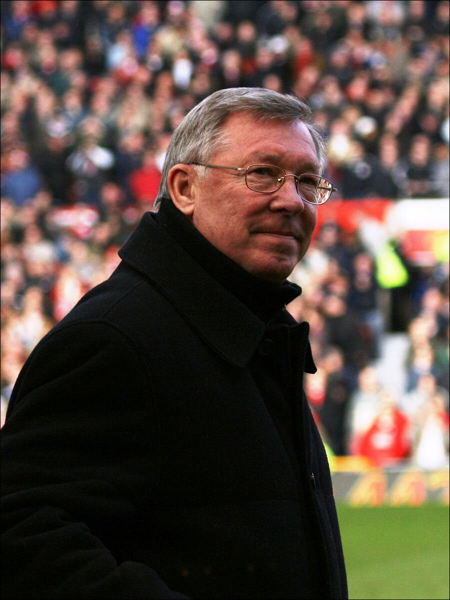 Sir Alex Ferguson, former Manchester United manager and victim of phone hacking, along with his son (Image by Austin Osuide CC 2.0)