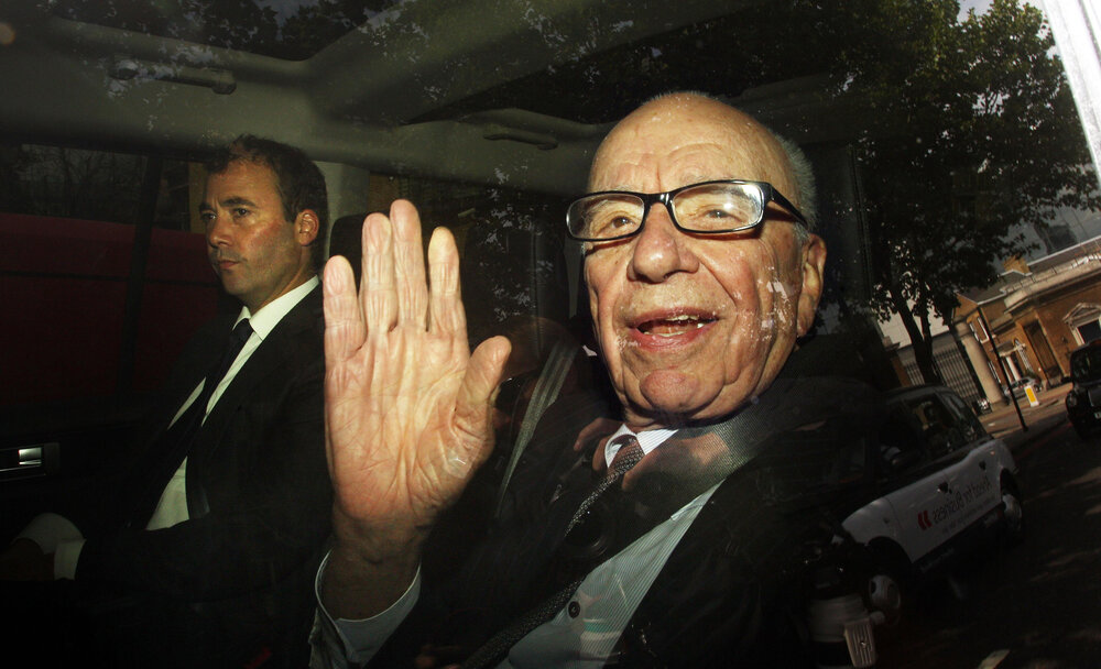 The boss: Rupert Murdoch leaves News International headquarters in Wapping, east London, with News International Group General Manager Will Lewis, in July 2011 (c) Lewis Whyld/PA Archive/PA Images