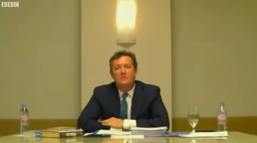Under oath: Piers Morgan being questioned by video link at the Leveson Inquiry in 2011 where he denied knowing about phone hacking