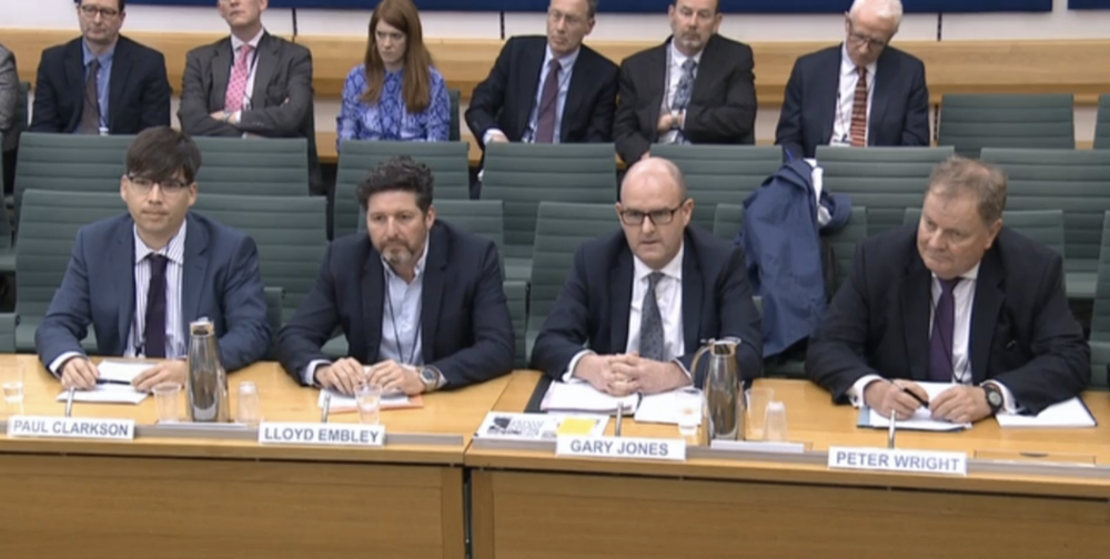 Top table:  Daily and Sunday Express Editor-in-Chief Gary Jones (middle right )  addressing a House of Commons Home Affairs Committee Inquiry on hate crime in 2018, along with other senior Fleet Street figures Managing Editor  The Sun  Paul Clarkson, Group Editor-in-Chief Trinity Mirror Lloyd Embley, and Editor Emeritus Associated Newspapers Peter Wright (c) PA