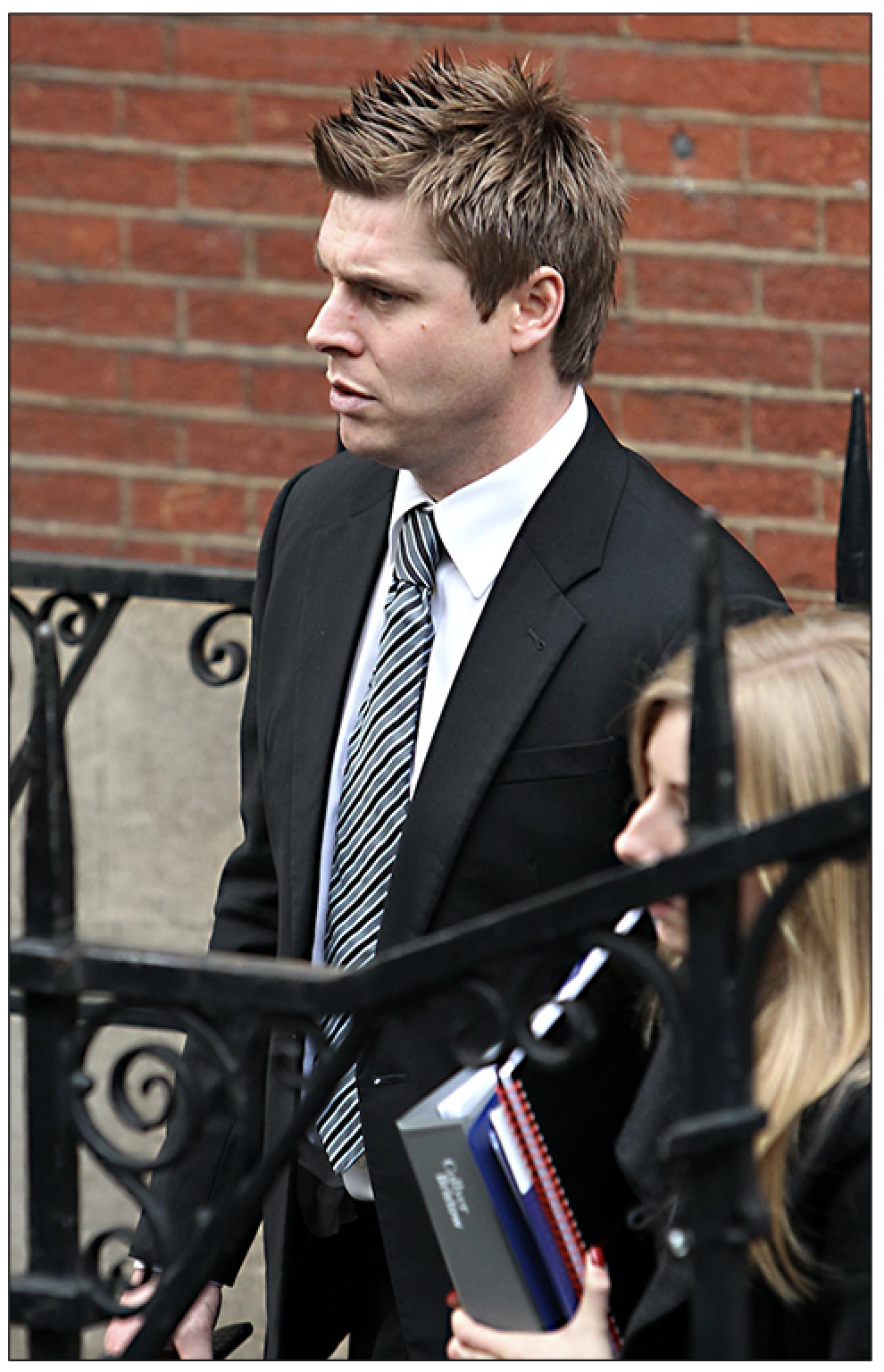 Garry Flitcroft leaves after he gave evidence to the Leveson Inquiry at The Royal Courts of Justice, The Strand, London, on 22 November 2011