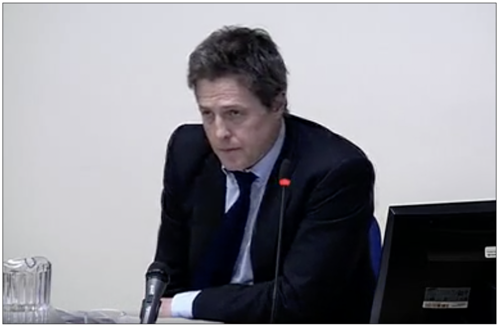 Evidence: Hugh Grant answering questions at the Leveson Inquiry in 2011