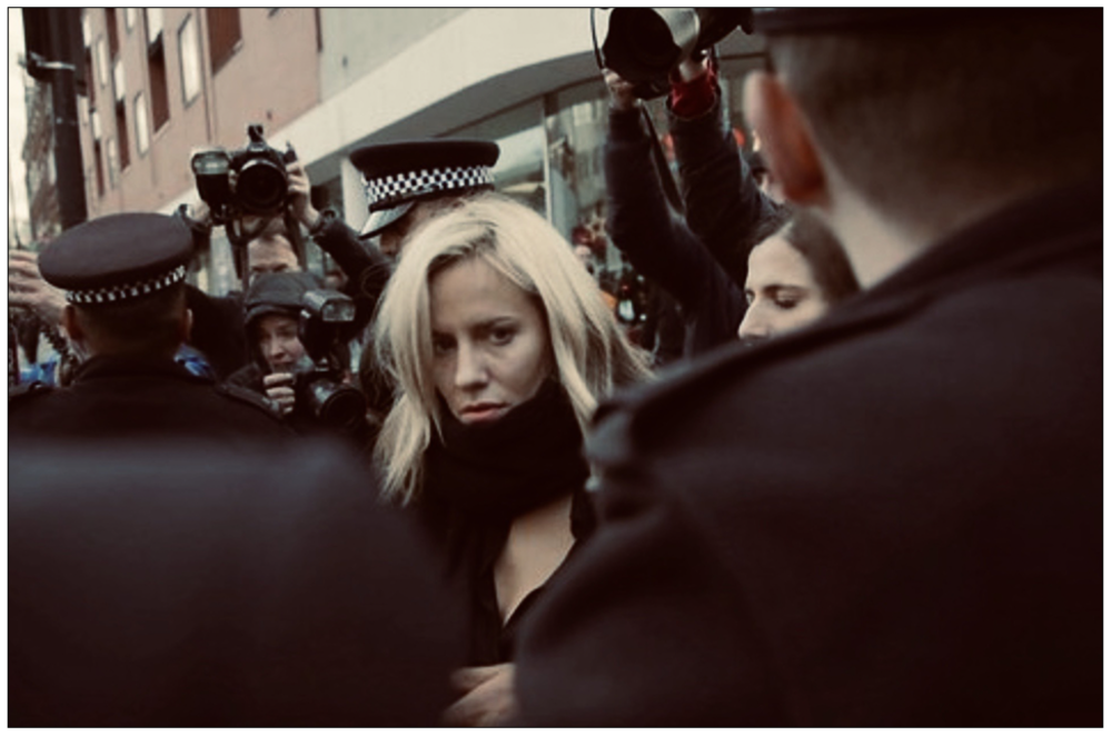 Swarmed: Caroline Flack pictured attending Highbury Magistrates' Court in December (c) Creative Commons