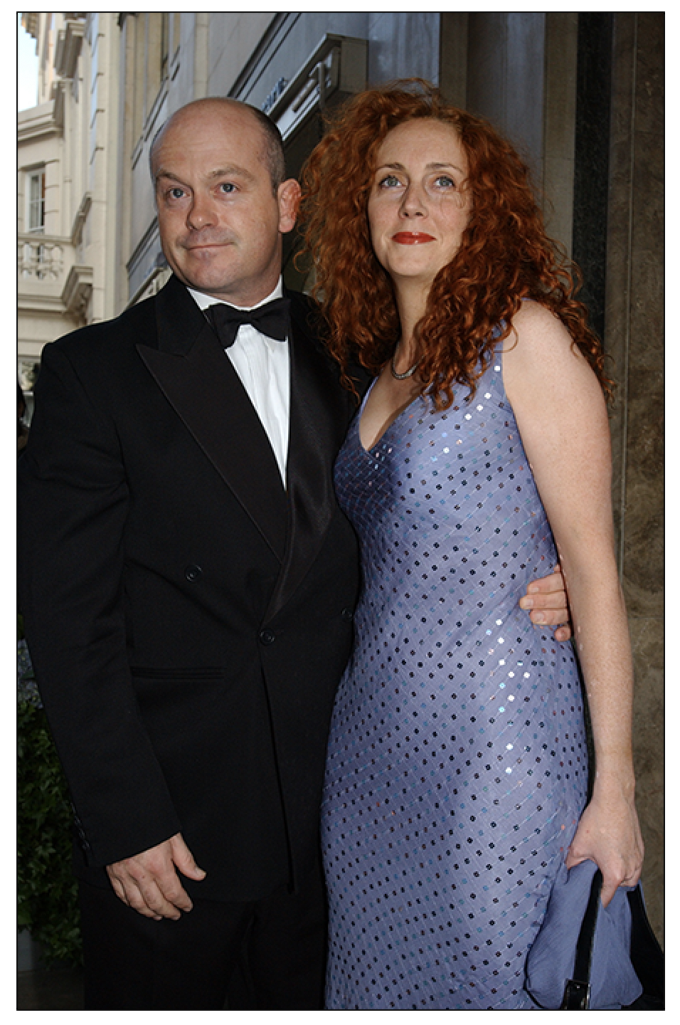 Ross Kemp and his then girlfriend Rebekah Wade pictured in 2002, arriving for the wedding reception of  Sun  columnist Jane Moore and Gary Farrow, at Claridge's Hotel in central London (c) PA