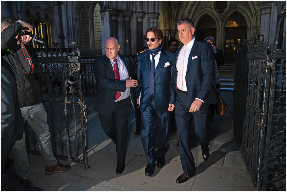 Johnny Depp court case:  Actor Johnny Depp (centre) leaving the High Court in London after attending a hearing in his libel case against the publishers of  The Sun  and its executive editor, Dan Wootton (c) PA