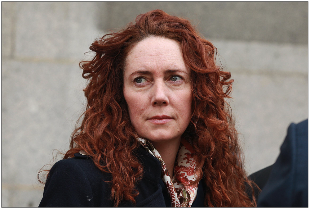 Pioneer:  Rebekah Brooks is said to have to introduced the 'blackmail model' of journalism to British tabloids when she first started editing Rupert Murdoch's  News of the World  in 2000
