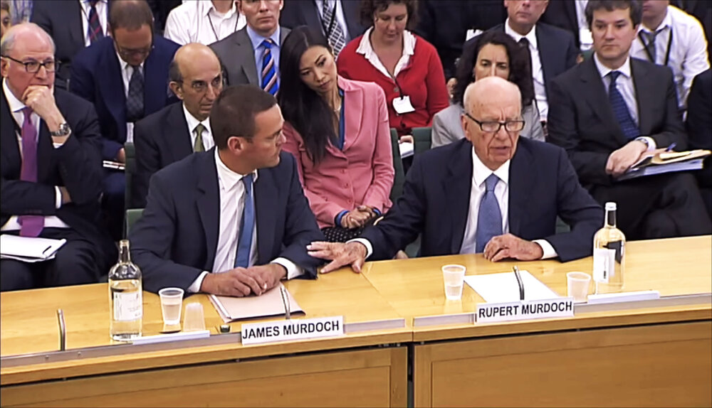 James and Rupert Murdoch apologise to the families and victims of phone hacking in 2011. (PA)