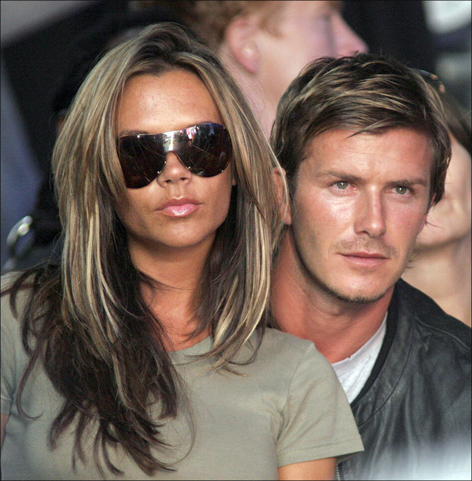 Settled:  Mirror Group hacked the former England football captain David Beckham ( pictured here with wife Victoria, at Live8 in July 2005 ) and then paid him damages. Now there are questions over what the plc's Board of Directors knew about criminality in their newsrooms (c) PA