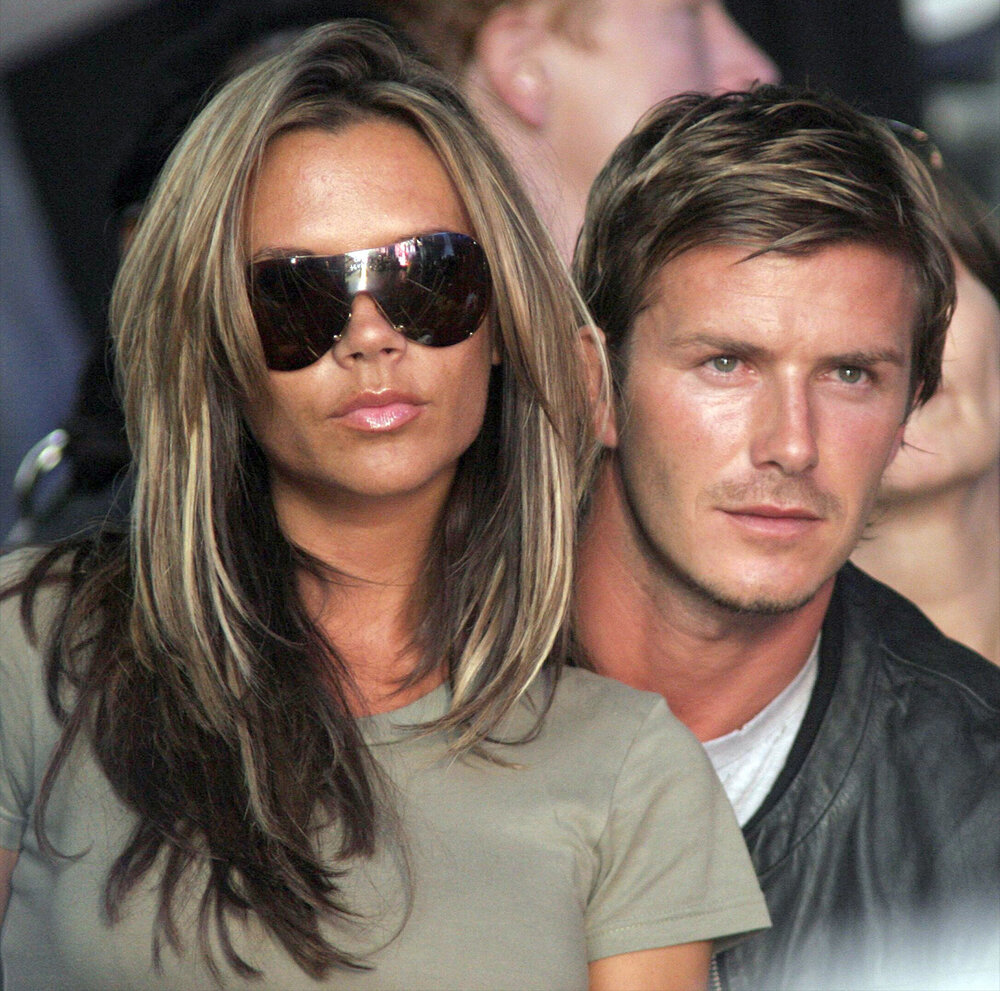 Target : former England captain David Beckham with wife Victoria at the Live 8 concert of 2005 (c) PA